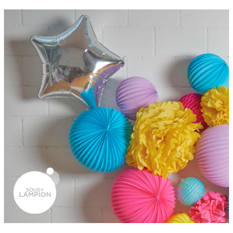 mylar star balloons in grouping of paper lanterns