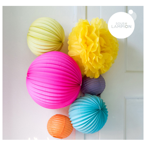 Paper pompom in a grouping of paper lanterns