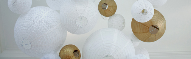 Gold and white paper lanterns ceiling