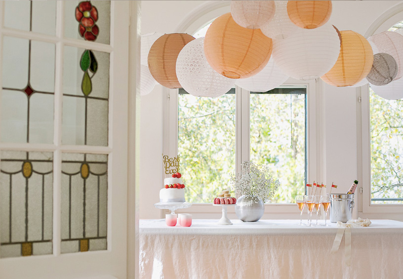 wedding paper lanterns over a dessert table