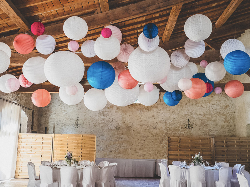 wedding paper lanterns in a barn