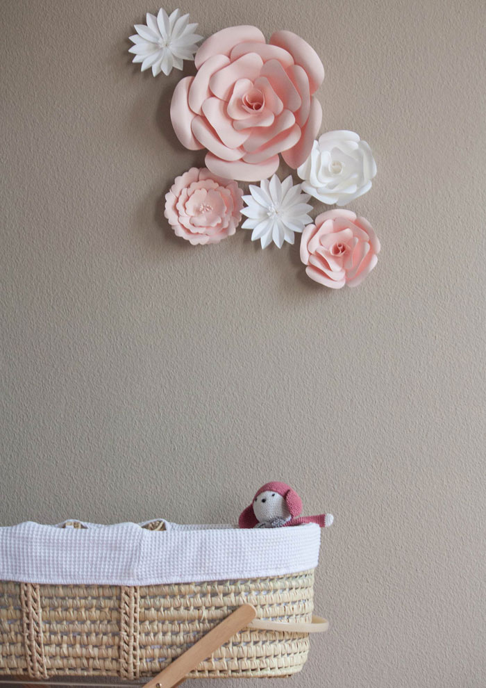 pink and white paper flowers wall decor for nursery | Under The Paper Lantern